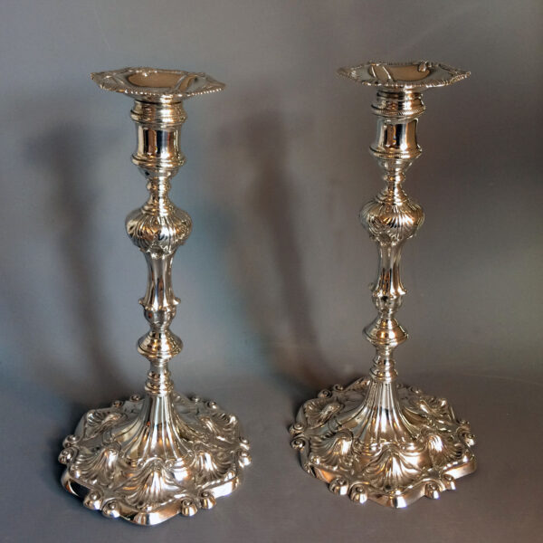 Pair of Ebenezer Cooker Georgian cast silver table candlesticks in superb condition. London 1764.